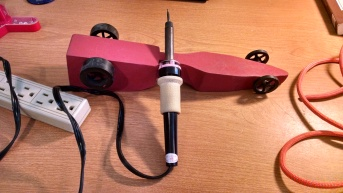 wooden car as a soldering stand